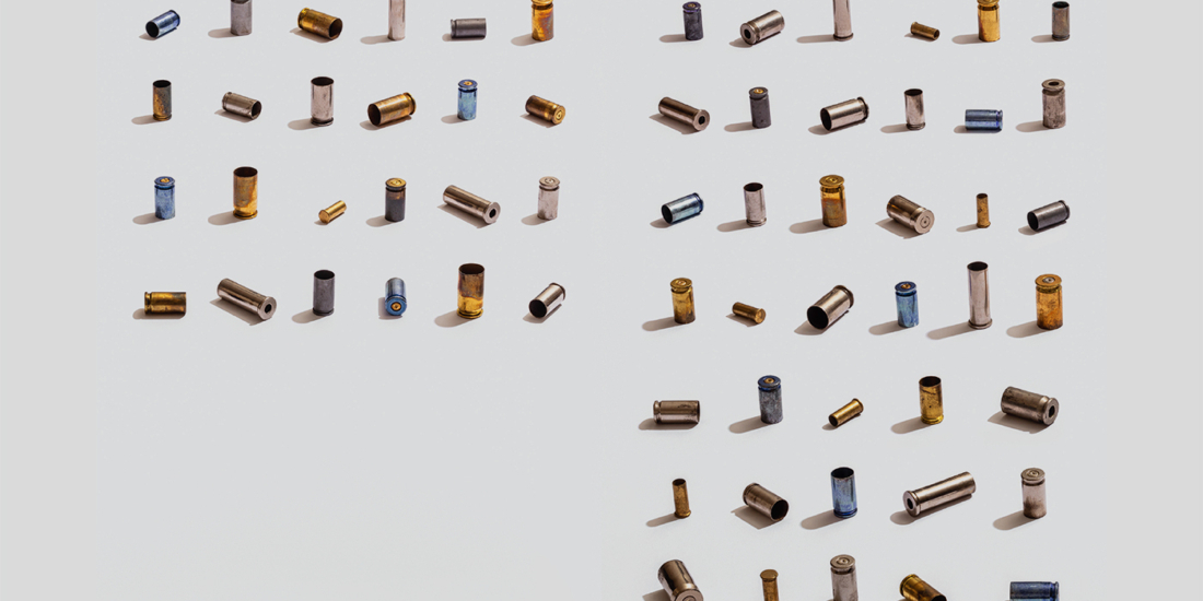 63 multicolored bullet shell casings representing the average number of gun suicides in a day