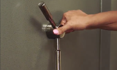 A woman's hand about to open a gun safe